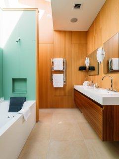 The skylighted master bath has dual sinks & a heated towel rack.