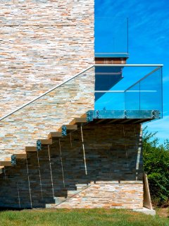 The pool can be directly accessed from the deck by the stairs floated off a stone monolith.