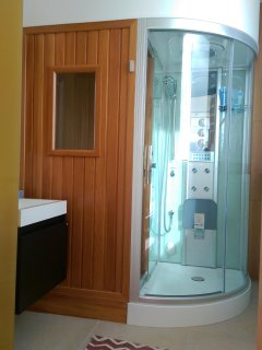 The ensuite 4th bedroom's bathroom includes a steam shower and a lava-rock sauna for 1-2 persons.