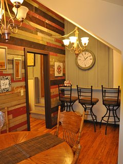Dining room with reclaimed wood wall