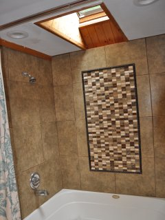 Framed tile mosaic surround with jet tub