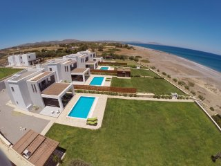Dionysos Beachfront Villa with private access to the best Beach on the island