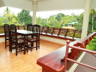 'Live in traditional Kerala style with 2 Deluxe and 2 Budget Rooms for 8 to 10'