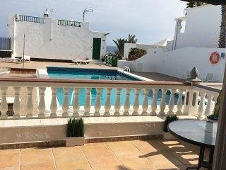 The private terrace overlooking the pool with sea views