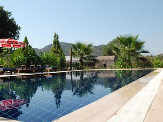 Kayakoy stone farmhouse /_ Villa Bilgın_ beautıful garden wıth big private pool