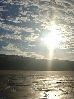 sunrise over the beach following a summer high tide