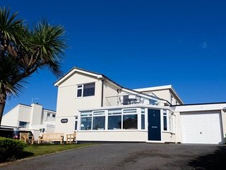 Beautifully styled coastal holiday home with sea views in popular village