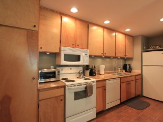 Updated kitchen with lots of cabinet space and fully stocked with all cooking utensils