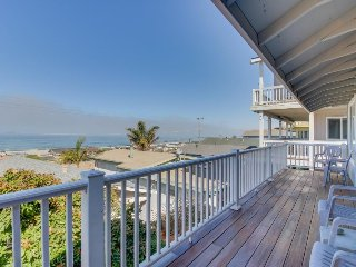 Charming, two-story home with deck, barbecue, and ocean views!