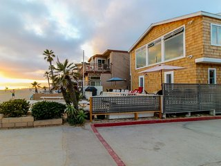Updated and spacious two-level oceanfront beach house - right on the sand
