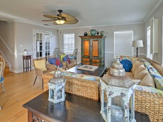 The home's spacious interior is beautifully decorated with beach-themed accents and wicker furnishings.