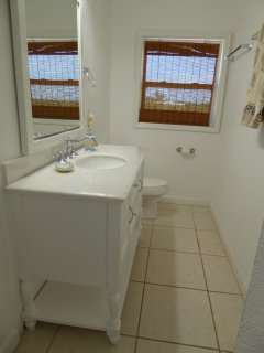 Clean and modern bathroom. Master bath en suite.