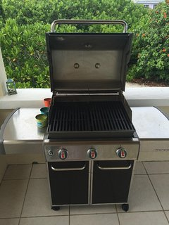 Enjoy grilling on this Weber grill in the shade of the back patio with an ocean view.