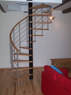 Spiral staircase leading to 2 bedrooms