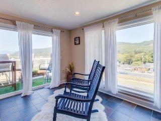 Dog-friendly home w/ private balcony & ocean views - easy walk to the beach!