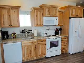 The well equipped kitchen has full size appliances for meal preparation