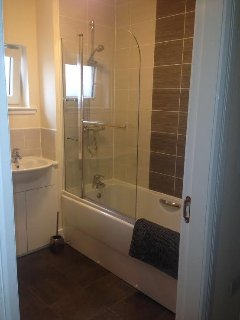 Upstairs Main Bathroom with over-bath shower