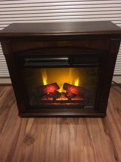 Electric Fireplace heats and provides atmosphere!
