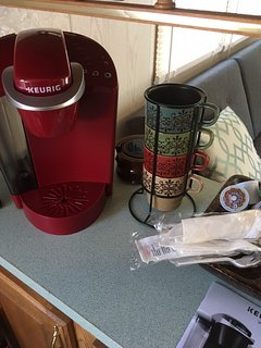 Keurig coffee bar complete with starter amount of coffee, tea, and condiments!