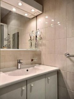 Bathroom 3  is equipped with : washbasin, shower, tiled floor, 1 separated toilet in the apartment.