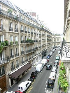 The apartment has a balcony facing street and ocntiguous to the living room, dining room and bedroom