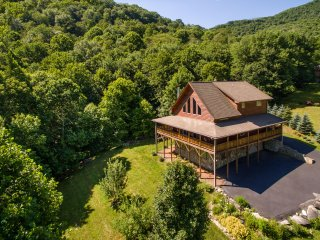 Luxury mountain home with private creek and beautiful views perfect for family.