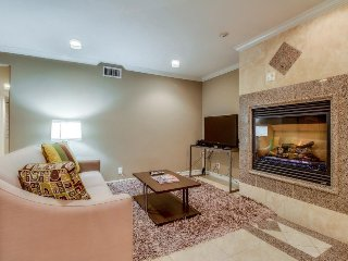 Gorgeous contemporary condo just steps from the beach! Includes relaxing patio!