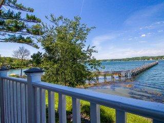 Riverfront condo w/ deck & shared hot tub - minutes to shops & restaurants!