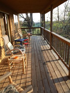Back deck with lots of seating on rockers and swing.