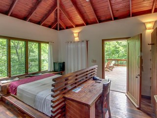 Treehouse-style home w/ jungle surroundings, beach, & spa-style services!
