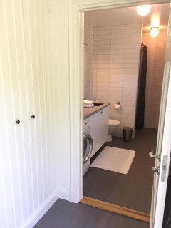 Bathroom with WC, shower, washer and floor heating