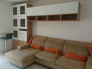 Appartamento con terrazza e posto auto privato coperto...