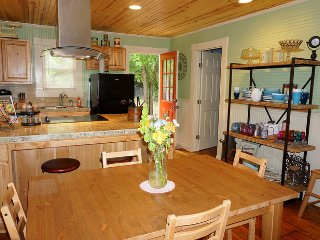 Kitchen has access to one bedroom and the back yard.