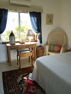 Ground floor romantic bedroom with sea views, fitted wardrobes and dressing table.