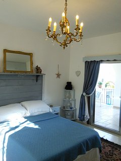 Romantic third double bedroom with fitted wardrobes and dressing table. Good sea views