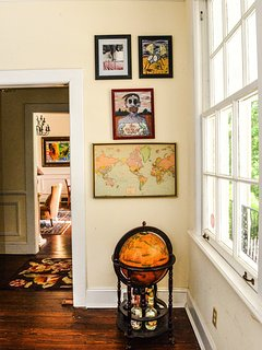 Guests like to place a pin  to mark their home on the vintage map in the dining room.