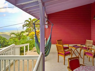 A colorful, 2 bedroom villa built in a traditional creole style with 2 terraces!