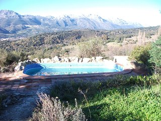 Spacious country getaway in andalusia w/ pool, stunning view of guardiaro valley