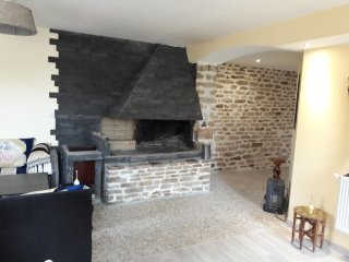 Access to the living room with its fireplace
