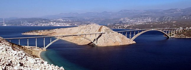 The island of Krk is connected to the mainland a bridge so you have to use any ferry.