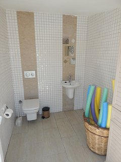 Poolside toilet