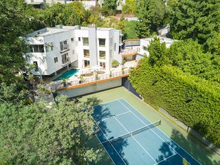 Hollywood Compound Featuring a Tennis Court, Pool, Outdoor Fireplace, Steam Room