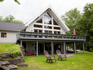 #102 Luxurious new chalet-style home on Moosehead Lake with large stone fireplac