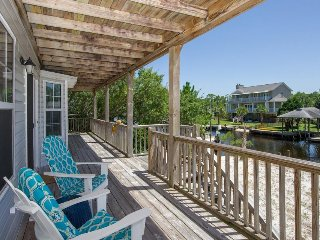 Spacious and family-friendly waterfront home with dock - close to the beach