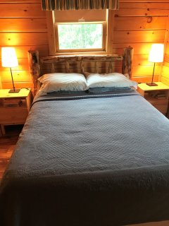 guest bedroom with handmade log headboard