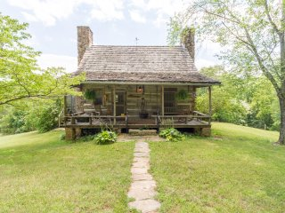 Original log cabin with one upstairs bedroom, fireplace, kitchen