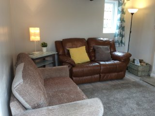 Relax in the Sitting Room, our leather sofa even reclines for your comfort!