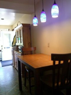 blue lights over-top dining table