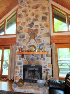 The floor to ceiling stone fireplace is perfect for staying warm in the chillier months.