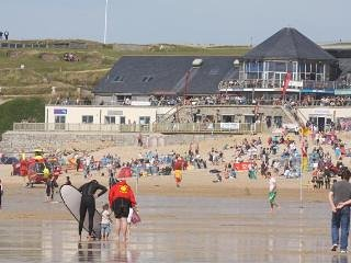 Fistral beach in Newquay  -- with the multi million pound surf centre,  bars restaurants  etc
